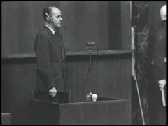 <p>Defendant Albert Speer is sworn in at the International Military Tribunal.</p>