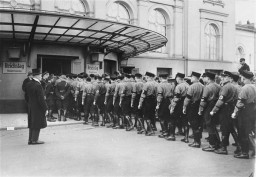 """<p>On the day of the vote on the so-called Enabling Act, the Nazi leadership sent SS troops into the makeshift <a href=""""/narrative/11083"""">Reichstag</a> building, formerly the Kroll Opera, to intimidate other political parties. Berlin, Germany, March 23, 1933.</p> <p>The <a href=""""/narrative/11465"""">Enabling Act</a> allowed the Reich government to issue laws without the consent of Germany's parliament, laying the foundation for the complete Nazification of German society. The full name of the law was the """"Law to Remedy the Distress of the People and the Reich.""""</p>"""