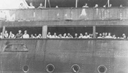 <p>Refugees aboard the <em>St. Louis</em> wait to hear whether Cuba will grant them entry. Off the coast of Havana, Cuba, June 3, 1939.</p>