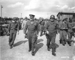 "<p>US General Dwight D. Eisenhower and General Troy Middleton, commanding general of the XVIII Corps, Third US Army, tour the newly liberated <a href=""/narrative/7757/en"">Ohrdruf</a> concentration camp. Ohrdruf, Germany, April 12, 1945.</p>"