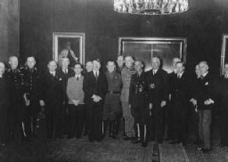 "<p><a href=""/narrative/43"">Adolf Hitler</a> poses with his cabinet shortly after assuming power as chancellor of Germany. Hitler is flanked by Joseph Goebbels (left) and Hermann Göring (right). Berlin, Germany, 1933.</p>"