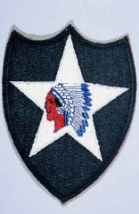 "<p>Insignia of the <a href=""/narrative/7965"">2nd Infantry Division</a>. The nickname of the 2nd Infantry Division, ""Indianhead,"" was derived from its <a href=""/narrative/28"">World War I</a> insignia. This insignia was developed from an emblem a truck driver in the division had painted on his truck.</p>"