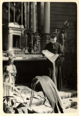 Father Wlodarczyk tries to clean a bombed-out church