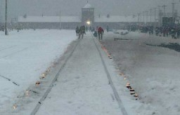 "<p>Candles mark the railway tracks leading to the <a href=""/narrative/3673/en"">Auschwitz</a> camp during the commemoration of the 60th anniversary of the <a href=""/narrative/2317/en"">liberation</a> of the camp. Poland, January 27, 2005.</p>"