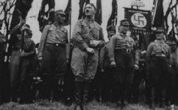 Adolf Hitler stands with an SA unit during a Nazi parade in Weimar [LCID: 02286]
