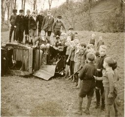 "<p>A group of young boys pose on and next to the demolished vehicle of local Jewish teacher Ferdinand Stern. The car had been driven to a nearby lake and set on fire during <a href=""/narrative/4063/en""><em>Kristallnacht</em></a>. Frankenberg, Germany, November 1938.</p>"