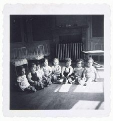 """<p>After the war, thousands of Jewish children ended up in orphanages all over Europe as a result of the Holocaust. The toddlers in this children's home in Etterbeek, Belgium, survived in <a href=""""/narrative/7711"""">hiding</a>, but their parents had been deported to <a href=""""/narrative/3673"""">Auschwitz</a>.</p>"""