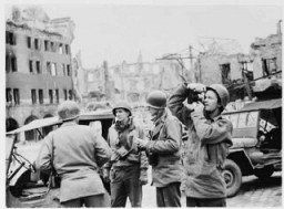 """<p><a href=""""/narrative/8129"""">US Army Signal Corps</a> photographers from Combat Unit 123 photograph ruins in the city of Naumburg, Germany. Photograph taken by <a href=""""/narrative/8148"""">J Malan Heslop</a>. April 10, 1945.</p>"""