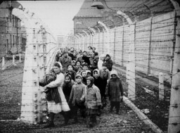 Child survivors of Auschwitz. Standing next to the nurse are Miriam and Eva Mozes. Behind them (wearing white hats) are Judy and Lea Csenghery. Both sets of sisters are twins.