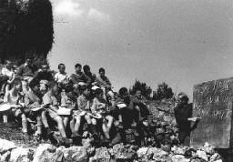 "<p>Some of the ""<a href=""/narrative/11006"">Tehran Children</a>,"" Polish Jewish refugees, study Hebrew in a Jewish National Fund youth village near Jerusalem. Palestine, March 9, 1943.</p>"