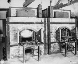"""<p>Two ovens inside the crematorium at the Dachau concentration camp. Dachau, Germany, July 1, 1945.</p> <p><span style=""""font-weight: 400;"""">This image is among the </span><a href=""""/narrative/8334/en""""><span style=""""font-weight: 400;"""">commonly reproduced and distributed</span></a><span style=""""font-weight: 400;""""> images of liberation. These photographs provided powerful documentation of the crimes of the Nazi era. </span></p>"""