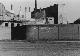 <p>A view of the wall surrounding the ruins of the Warsaw ghetto in German-occupied Poland a few months after the ghetto's destruction. Photograph taken ca. June-October 1943. </p>