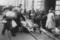 "<p>Arrival of a transport of Dutch Jews in the <a href=""/narrative/5386/en"">Theresienstadt</a> ghetto. Czechoslovakia, February 1944.</p>"