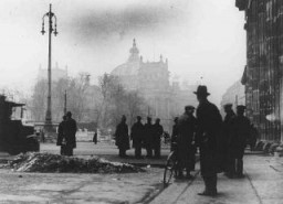 Onlookers in front of the Reichstag (German parliament) building after its virtual destruction by fire. [LCID: 75102]