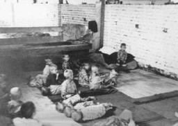 "<p>Children sit and sleep on the floor at Sisak, a Ustasa (Croatian fascist) concentration camp for children. <a href=""/narrative/6153/en"">Yugoslavia</a>, during World War II.</p>"