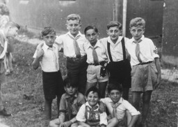 """<p>Elementary school-age members of Hashomer Hatzair in the <a href=""""/narrative/53598/en"""">Stuttgart</a> displaced persons camp, circa 1946–1949. Lova Warszawczyk is standing in the center.</p>"""