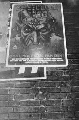"<p>A poster advertising the antisemitic propaganda film ""Der ewige Jude"" (The Eternal Jew) hangs on the side of a Dutch building. Amsterdam, The Netherlands, 1942.</p>"