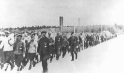 "<p>Returning from work in a stone quarry, <a href=""/narrative/3384/en"">forced laborers</a> carry stones more than six miles to the <a href=""/narrative/3956/en"">Buchenwald</a> concentration camp. Germany, date uncertain.</p>"