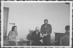 <p>US prosecutor Robert Kempner shows a document to German Field Marshal Erich von Manstein at the International Military Tribunal commission hearings investigating indicted Nazi organizations. Also pictured is the interpreter, a Mrs. Lowenstein. July 1946.</p>
