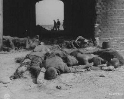 "<p>Burned bodies of former prisoners of Rottleberode, a subcamp of <a href=""/narrative/4909/en"">Dora-Mittelbau</a>, lie near the entrance to a barn that had been set on fire by SS troops while the prisoners were on a <a href=""/narrative/2931/en"">death march</a>. Gardelegen, Germany, April 18, 1945.</p>"