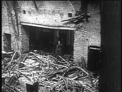 """<p>This footage shows the <em>Reichstag</em> (German parliament) building on the day after it was set on fire. Blaming Communists for the incident, Hitler suspended constitutional guarantees and expelled Communist and Socialist deputies from the parliament. Shortly after the decree was issued, the Nazis established<a href=""""/narrative/4656/en"""">concentration camps</a> for the internment of <a href=""""/narrative/11082/en"""">political opponents</a>.</p>"""