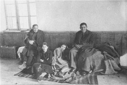 """<p>Afamily of Macedonian Jews in the Tobacco Monopoly transit camp in Skopjebeforedeportation. Skopje, Yugoslavia, March 1943.</p> <p><span style=""""font-weight: 400;"""">The Jews of <a href=""""/narrative/5955/en"""">Bulgarian-occupied</a> Thrace and Macedonia were deported in March 1943. On March 11, 1943, over 7,000 Macedonian Jews from Skopje, Bitola, and Stip were rounded up and assembled at the Tobacco Monopoly in Skopje, whose several buildings had been hastily converted into a transit camp. The Macedonian Jews were kept there between eleven and eighteen days, before being deported by train in three transports between March 22 and 29, to <a href=""""/narrative/3819/en"""">Treblinka</a>.</span></p>"""