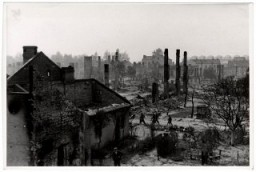 "<p>Poles walk among the ruins of besieged <a href=""/narrative/2014"">Warsaw</a>.</p>