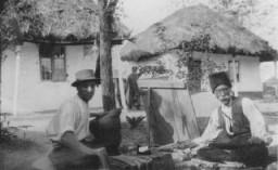 """<p>Two <a href=""""/narrative/5123"""">Romani (Gypsy) artisans</a>. Ploesti, Romania, 1930s.</p>"""