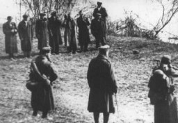 <p>Arrow Cross Party members execute Jews along the banks of the Danube River. Budapest, Hungary, 1944.</p>