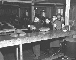 <p>Jewish displaced persons receive food aid from the United Nations Relief and Rehabilitation Administration (UNRRA), at the Bindermichl displaced persons camp in the US zone. Linz, Austria, date uncertain.</p>