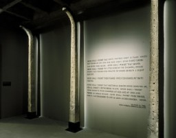 "<p>This photograph shows <a href=""/narrative/3673/en"">Auschwitz</a> fence posts and a quote from <a href=""/narrative/10130/en"">Elie Wiesel</a>'s <em>Night</em> . They are on display in the third floor tower room of the Permanent Exhibition at the United States Holocaust Memorial Museum.</p>