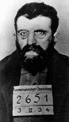 "<p>Identification picture of Erich Mühsam taken in the Oranienburg concentration camp. Mühsam, an anarchist and a pacifist, worked as an editor and writer; he was imprisoned during World War I for opposing the war. Arrested during the massive roundup of Nazi <a href=""/narrative/11082"">political opponents</a> following the <a href=""/narrative/11083"">Reichstag fire</a> (February 27, 1933), Mühsam was tortured to death in Oranienburg on July 11, 1934. Oranienburg, Germany, February 3, 1934.</p>"