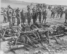 "<p>General Dwight D. Eisenhower (third from left) views the charred remains of inmates of the <a href=""/narrative/7757/en"">Ohrdruf</a> camp. Ohrdruf, Germany, April 12, 1945.</p>"