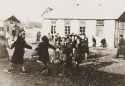 <p>Romani (Gypsy) children play outside at the Jargeau internment camp. The camp was established in response to a German order in October 1940 calling for the arrest and confinement in camps of all Frenchmen or foreigners in the Loiret region who did not have a permanent residence. Jargeau, France, 1941–45.</p>