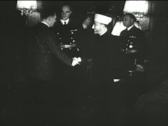 "<p>In this German propaganda newsreel, the former Mufti of Jerusalem, Hajj Amin al-Husayni, an Arab nationalist and prominent Muslim religious leader, meets Hitler for the first time. During the meeting, held in in the Reich chancellery, Hitler declined to grant al-Husayni's request for a public statement--or a secret but formal treaty--in which Germany would: 1) pledge not to occupy Arab land, 2) recognize Arab striving for independence, and 3) support the ""removal"" of the proposed Jewish homeland in Palestine. The Führer confirmed that the ""struggle against a Jewish homeland in Palestine"" would be part of the struggle against the Jews. Hitler stated that: he would ""continue the struggle until the complete destruction of Jewish-Communist European empire""; and when the German army was in proximity to the Arab world, Germany would issue ""an assurance to the Arab world"" that ""the hour of liberation was at hand."" It would then be al-Husayni's ""responsibility to unleash the Arab action that he has secretly prepared."" The Führer stated that Germany would not intervene in internal Arab matters and that the only German ""goal at that time would be the annihilation of Jewry living in Arab space under the protection of British power.""</p>"