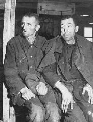 """<p>Two malnourished <a href=""""/narrative/10135/en"""">Soviet prisoners of war</a>, survivors of the Hemer prisoner of war camp in western Germany. More than three million Soviet prisoners of war died in German custody, mostly from malnutrition and exposure. Hemer, Germany, April 29, 1945.</p>"""
