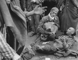 <p>Survivors waiting for to be evacuated from the Wöbbelin concentration camp to receive medical attention at a field hospital. Germany, May 4, 1945.</p>