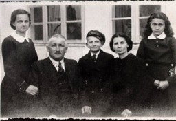 "<p><a href=""/narrative/10366/en"">Lisa Nussbaum</a> and her family. From left to right: Pola (sister), Herschel (father), Borushek (brother) Gittel (mother), and Lisa (about 13 years old in this photograph). Lisa's father exported geese to Germany for a living. Photograph taken in Raczki, Poland, ca. 1939.</p>