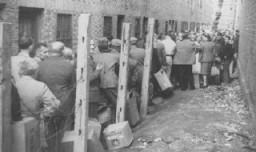 "<p>Jewish refugees line up to receive food provided by the <a href=""/narrative/5002"">American Jewish Joint Distribution Committee</a> (JDC) after the war. Shanghai, China, 1945-1946.</p>"