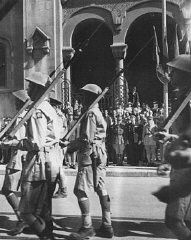 Allied troops march in Tunis following Allied success against Axis forces in the African Campaign. [LCID: tl165]