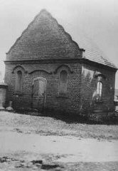 "<p>Postwar photograph of a building in Dabie where the possessions of Jews killed at the nearby <a href=""/narrative/3852"">Chelmno</a> killing center were stored. Dabie, Poland, June 1945.</p>"