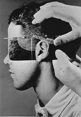 <p>Establishing racial descent by measuring an ear at the Kaiser Wilhelm Institute for Anthropology. Germany, date uncertain.</p>