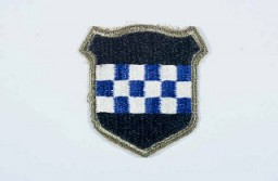 "<p>Insignia of the <a href=""/narrative/7951"">99th Infantry Division</a>. The 99th Infantry Division, the ""Checkerboard"" division, gained its nickname from the division's insignia. The insignia was devised upon the 99th's formation in 1942, when the division was headquartered in the city of Pittsburgh. The blue and white checkerboard in the division's insignia is taken from the coat of arms of William Pitt, for whom Pittsburgh is named. The division was also known as the ""Battle Babies"" during 1945, a sobriquet coined by a United Press correspondent when the division was first mentioned in press reports during the <a href=""/narrative/8156"">Battle of the Bulge</a>.</p>"