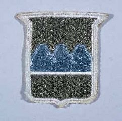 "<p>Insignia of the <a href=""/narrative/8053/en"">80th Infantry Division</a>. The nickname of the 80th Infantry Division, the ""Blue Ridge"" division, reflects the home states of the majority of soldiers who formed the division during World War I: Pennsylvania, West Virginia, and Virginia. The Blue Ridge Mountains run through these three states.</p>"