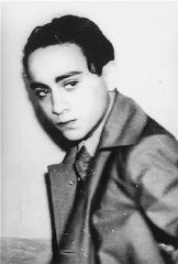 <p>Portrait of Herschel Grynszpan taken after his arrest by French authorities for the assassination of German diplomat Ernst vom Rath. Grynszpan (1921-1943?).</p> <p>Born in Hannover, Germany, was the son of Polish Jews who had immigrated to Germany. In 1936 Grynszpan fled to Paris. On November 7, 1938, after having learned of theexpulsion of his parents from Germany to Zbaszyn the Polish frontier, Grynszpan assassinated Ernst vom Rath, the third secretary of the German embassy in Paris. The diplomat's subsequent death two days later was used by the Nazi regime as justification for unleashing the <em>Kristallnacht</em> pogrom of November 9–10. In 1940 Grynszpan was turned over to the Germans by the Vichy government, but the date and place of his death have never been clarified.</p> <p>Photograph taken in Paris, France, November 7, 1938.</p>