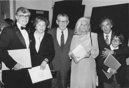 <p>Elie Wiesel (right) with his wife and son during the Faith in Humankind conference, held several years before the opening of the United States Holocaust Memorial Museum. September 18–19, 1984, in Washington, DC.</p>