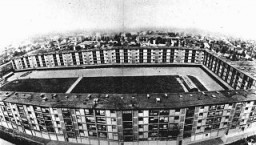 """<p>This multistory complex served as the <a href=""""/narrative/4438/en"""">Drancy</a> transit camp. The overwhelming majority of Jews deported from France were held here prior to their deportation. Drancy, France, 1941–44.</p>"""