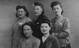 """<p>A group of Jewish women in Paris. They arewearing the required yellow <a href=""""/narrative/11750/en"""">badges</a>. Paris, France, June 8, 1942.</p>"""