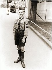 """<p>A Hitler Youth poses for a photograph in the Rhineland city of Bruehl, 1934. The Hitler Youth and the League of German Girls were the primary tools that the Nazis used to <a href=""""/narrative/11357/en"""">shape the beliefs</a>, thinking and actions of German youth.</p>"""