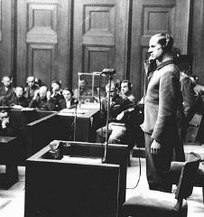 "<p>Defendant Karl Brandt testifies during the <a href=""/narrative/9245/en"">Doctors Trial</a>. Nuremberg, Germany, December 9, 1946-August 20, 1947.</p>"
